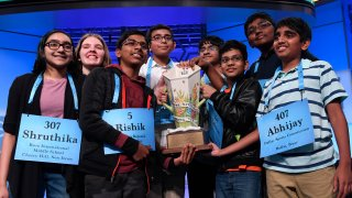 The eight co-champions of the 2019 Scripps National Spelling Bee, from left, Shruthika Padhy, 13, of Cherry Hill, N.J., Erin Howard, 14, of Huntsville, Ala., Rishik Gandhasri, 13, of San Jose, Calif., Christopher Serrao, 13, of Whitehouse Station, N.J., Saketh Sundar, 13, of Clarksville, Md., Sohum Sukhatankar, 13, of Dallas, Texas, Rohan Raja, 13, of Irving, Texas, and Abhijay Kodali, 12, of Flower Mound, Texas, hold the trophy at the end of the competition in Oxon Hill, Md., Friday, May 31, 2019.