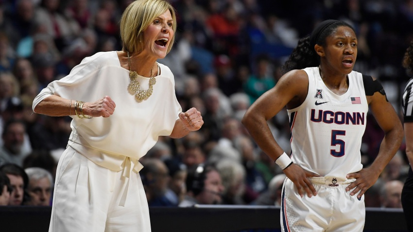 Connecticut associate head coach Chris Dailey, left, and Connecticut's Crystal Dangerfield react in the first half of an NCAA college basketball game against Oklahoma, Sunday, Dec. 22, 2019, in Uncasville, Connecticut.
