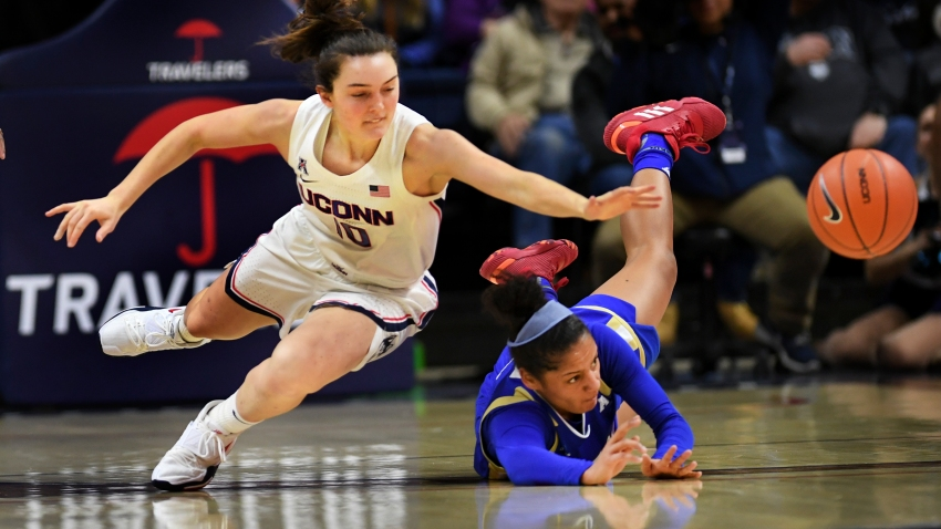 Connecticut's Molly Bent (10) goes for the ball against Tulsa's Rebecca Lescay