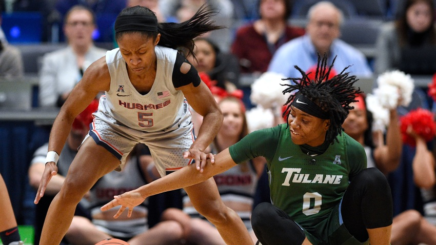 Tulane's Arsula Clark, right, is pressured by Connecticut's Crystal Dangerfield, left, in the first half of an NCAA college basketball game, Wednesday, Feb. 19, 2020, in Hartford, Conn.