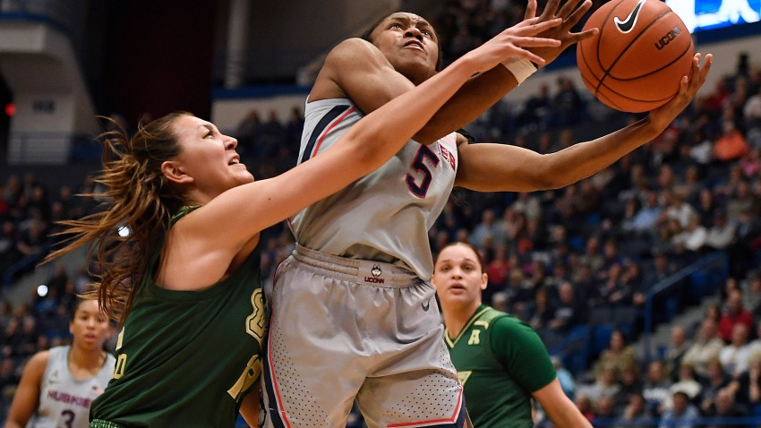 South Florida's Cristina Bermejo, left, fouls Connecticut's Crystal Dangerfield in the first half of an NCAA college basketball game, Monday, March 2, 2020, in Hartford, Conn.
