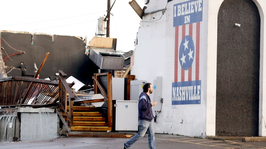 A man walks by The Basement East, a live music venue destroyed by storms Tuesday, March 3, 2020, in Nashville, Tenn.