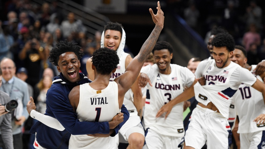 Connecticut's Temi Aiyegbusi embraces Connecticut's Christian Vital