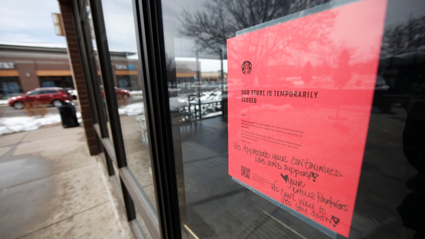 A sign tells customers that Starbucks cafe is closed temporarily as residents deal with the spread of coronavirus Saturday, March 21, 2020, in Denver.