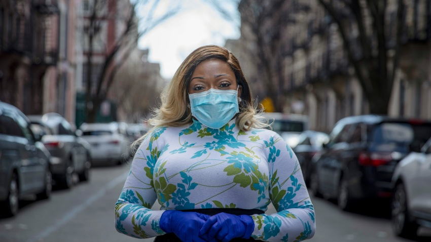 """Tiffany Pinckney poses for a portrait in the Harlem neighborhood of New York on April 1, 2020. After a period of quarantine at home separated from her children, she has recovered from COVID-19. Pinckney became one of the nations first donors of """"convalescent plasma."""" Using the blood product is experimental but scientists hope it could help treat the seriously ill and plan to test if it might offer some protection against infection for those at high risk."""