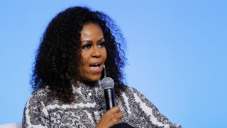 In this Dec. 12, 2019, file photo, former U.S. fist lady Michelle Obama speaks during an event for Obama Foundation in Kuala Lumpur, Malaysia.