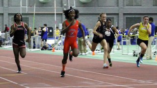 Bloomfield High School's Terry Miller, second from left, wins the final of the 55-meter dash over Andraya Yearwood, far left, and other runners in the Connecticut girls Class S indoor track meet at Hillhouse High School in New Haven, Connecticut.
