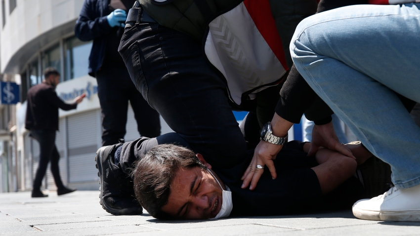 In this May 1, 2020, file photo, Turkish police officers arrest a demonstrator wearing a face mask for protection against the coronavirus, during May Day protests near Taksim Square, in Istanbul. The death of George Floyd has renewed scrutiny of immobilization techniques long used in policing around the world.