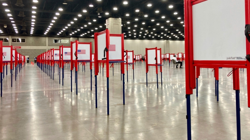 Voting stations are set up for the primary election at the Kentucky Exposition Center, Monday, June 22, 2020, in Louisville, Ky. With one polling place designated for Louisville on Tuesday, voters who didn't cast mail-in ballots could potentially face long lines in Kentucky's unprecedented primary election.