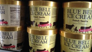 In this April 10, 2015, file photo, Blue Bell ice cream rests on a grocery store shelf in Lawrence, Kan. Blue Bell Creameries agreed to pay more than $19 million in fines and forfeiture on May 1, 2020, as part of a plea agreement on two misdemeanor counts for shipping contaminated ice cream, according to the U.S. Department of Justice.