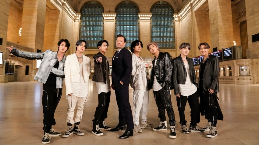 """In this Feb. 24, 2020, file photo, (l-r) Jin, Jimin, and Jungkook of BTS, with host Jimmy Fallon and V, RM, SUGA, and J-Hope of BTS perform for """"The Tonight Show Starring Jimmy Fallon"""" in Grand Central Terminal."""