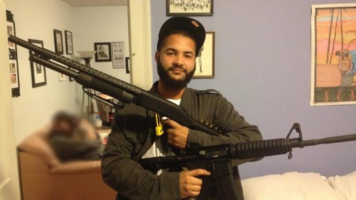 Darnell Jerome Davis with guns blurred