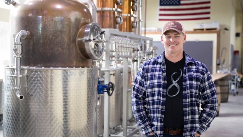 Chad Butters, founder of Eight Oaks Farm Distillery, poses for a photo at their facility in New Tripoli, Pa., Monday, March 16, 2020. Butters, who grew increasingly angry as he saw the skyrocketing price of hand sanitizer, has decided to do something about it: He's temporarily converting his operation into a production line for the suddenly hard-to-find, gooey, alcohol-based disinfectant.