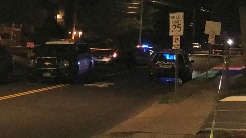 Police cruisers at the scene of a fatal stabbing in Hartford