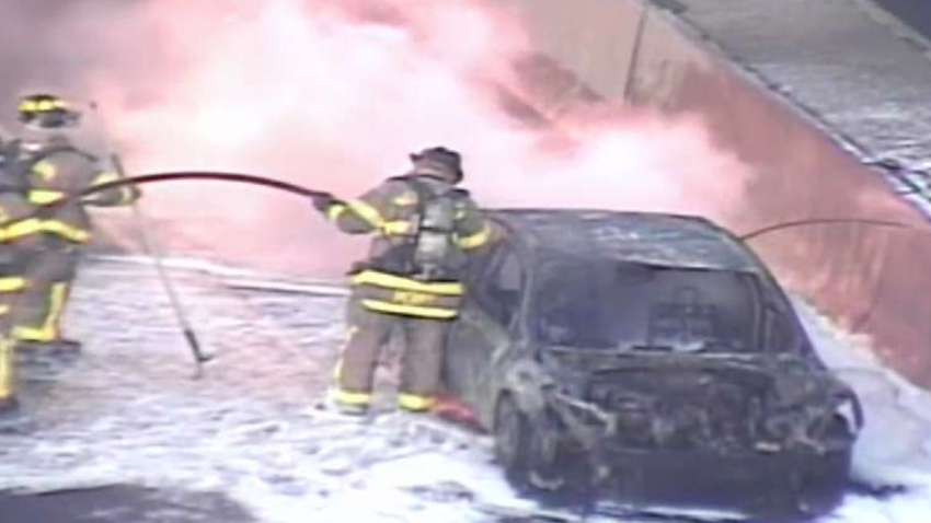 A car on fire on Interstate 95 in West Haven