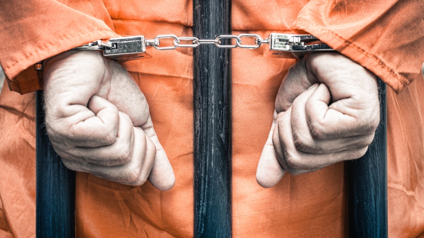 File Image: Generic man in handcuffs