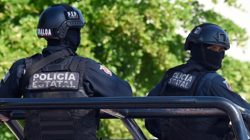 File photo - Policemen stand guard in the area where heavily armed gunmen waged an all-out battle against Mexican security forces in Culiacan, Sinaloa state, Mexico, on Oct. 18, 2019.