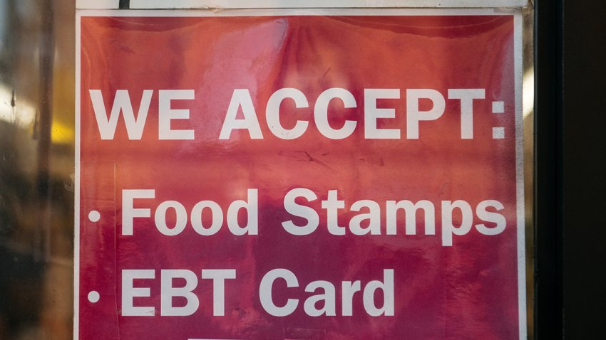A poster stating they accept the food stamps and EBT card.