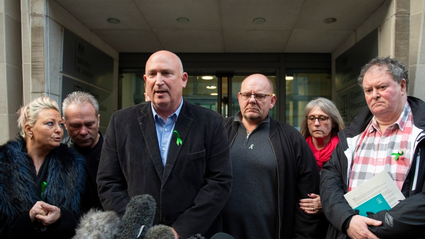 This Dec. 20, 2019, photo shows the family of Harry Dunn — from left to right: mother Charlotte Charles, stepfather Bruce Charles, family spokesman Radd Seiger, father Tim Dunn, stepmother Tracey Dunn and solicitor Mark Stephens — outside the Ministry of Justice in London after meeting with the director of Public Prosecutions.