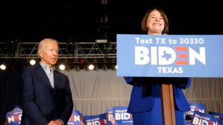 File photo - Sen. Amy Klobuchar (D-MN) joins Democratic presidential candidate former Vice President Joe Biden on stage during a campaign event on March 2, 2020, in Dallas.