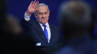 In this Tuesday, March 3, 2020, photo, Israeli Prime Minister Benjamin Netanyahu gestures as he speaks to supporters following the announcement of exit polls in Israel's election at his Likud party headquarters in Tel Aviv.