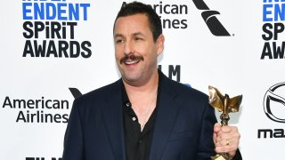 """In this Feb. 8, 2020, file photo, Adam Sandler, winner of Best Male Lead for """"Uncut Gems,"""" poses in the press room at the 2020 Film Independent Spirit Awards in Santa Monica, California."""