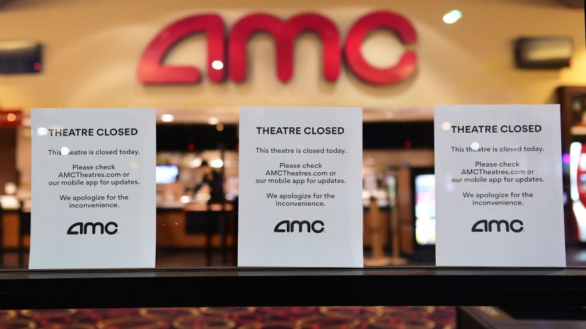 """Theater Closed"" signs are posted in front of an AMC movie theater"