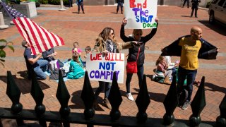 Protesters rally against stay-at-home orders related to the coronavirus pandemic outside Capitol Square in Richmond, Virginia on April 16, 2020.