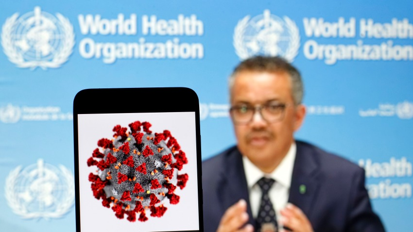 In this photo illustration the World Health Organization Director General Tedros Adhanom Ghebreyesus is seen on a screen of pc and a coronavirus image displayed on a screen of a smartphone in Kiev, Ukraine.