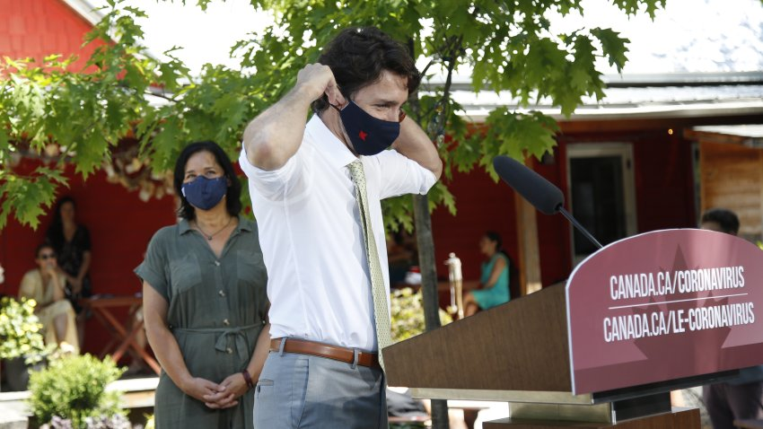 Justin Trudeau, Canada's prime minister, puts on a protective mask following a news conference in Chelsea, Quebec, Canada, on Friday, June 19, 2020. The federal governmentsaidearlier this month landlords had applied for only C$90 million ($66 million) from a rent assistance fund on behalf of about 26,000 tenants. That's less than 5% of its estimate of C$2 billion when the program wasintroducedin April.