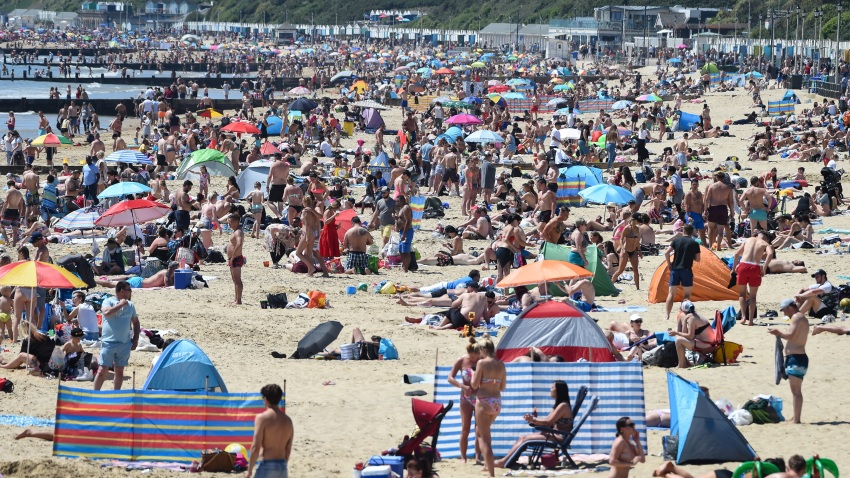 Tourists enjoy the hot weather at the beach in Bournemouth, U.K.