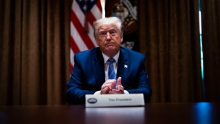 """In this June 15, 2020, file photo, U.S. President Donald Trump listens during a roundtable on """"Fighting for America's Seniors"""" at the Cabinet Room of the White House in Washington, DC."""
