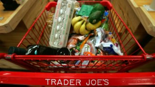 Trader Joe's shopping cart full of groceries.