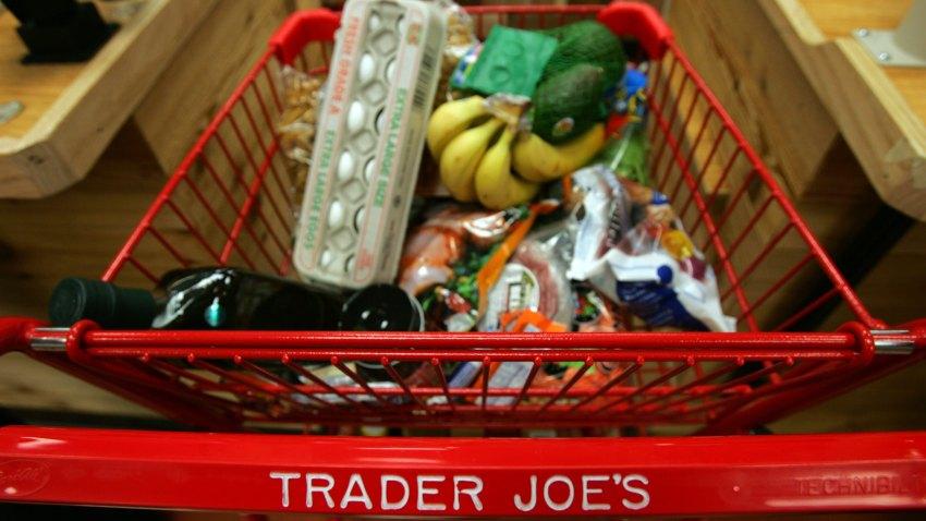 Trader Joe's shopping cart full of groceries.