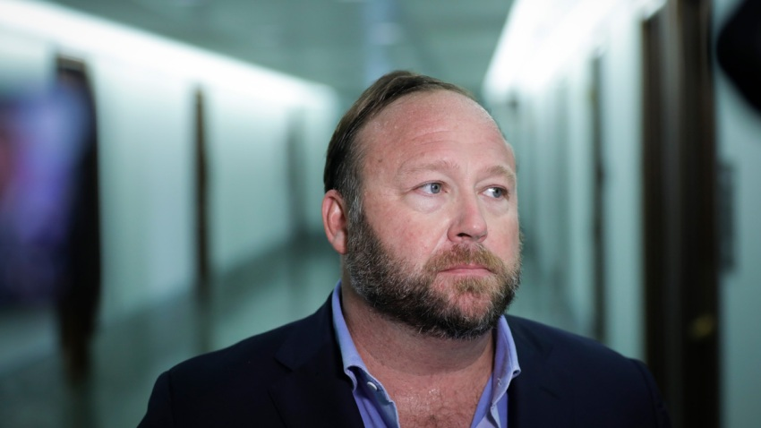 Alex Jones talks to reporters after Senate hearing