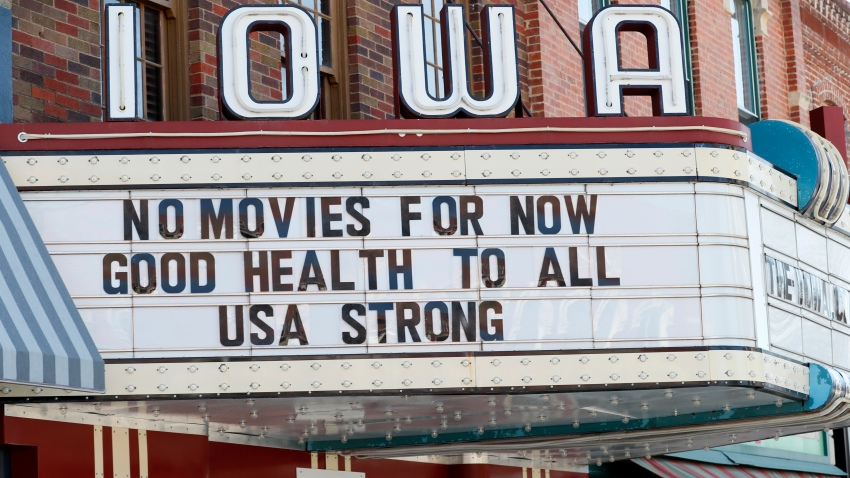 In this April 1, 2020, file photo, the marquee for the Iowa Theater, closed in response to the coronavirus outbreak, is seen on John Wayne Drive in Winterset, Iowa.