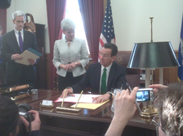Malloy signing