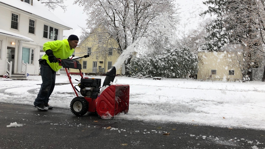 Person using snowblower to clear wnow