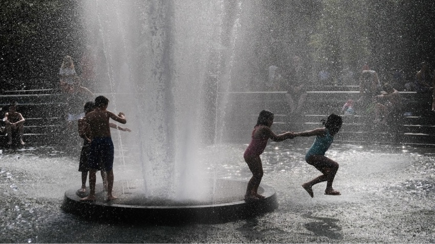 Children playing in water during a heat wave in New York City