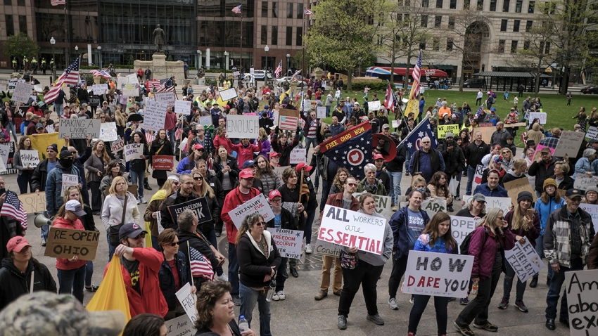 Demonstrators protest statewide lockdown measures, which were implemented to prevent the spread of the novel coronavirus, outside the Ohio Statehouse in Columbus, Ohio, May 1, 2020.