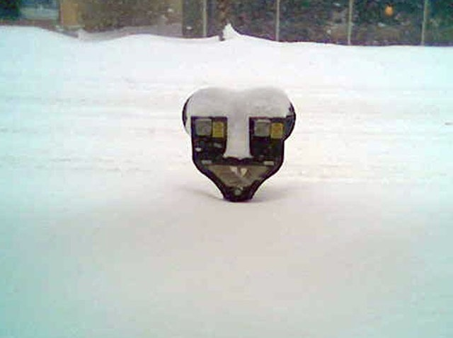 Parking meter in snow