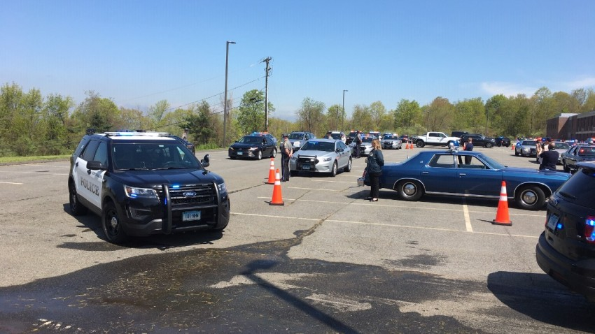 police cruisers lined up for a parade to honor fallen officers