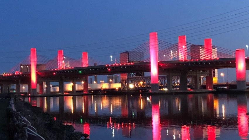 Q bridge lit in red