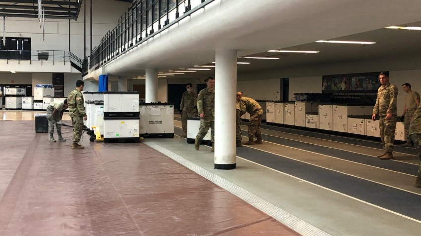 national guard soldiers move medical supplies into the field house at southern Connecticut state university