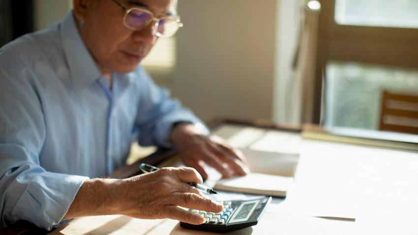 Senior man calculating finances