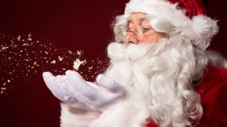 Santa Claus storyblocks-santa-claus-blowing-some-snowflakes_rvlxls-FqM