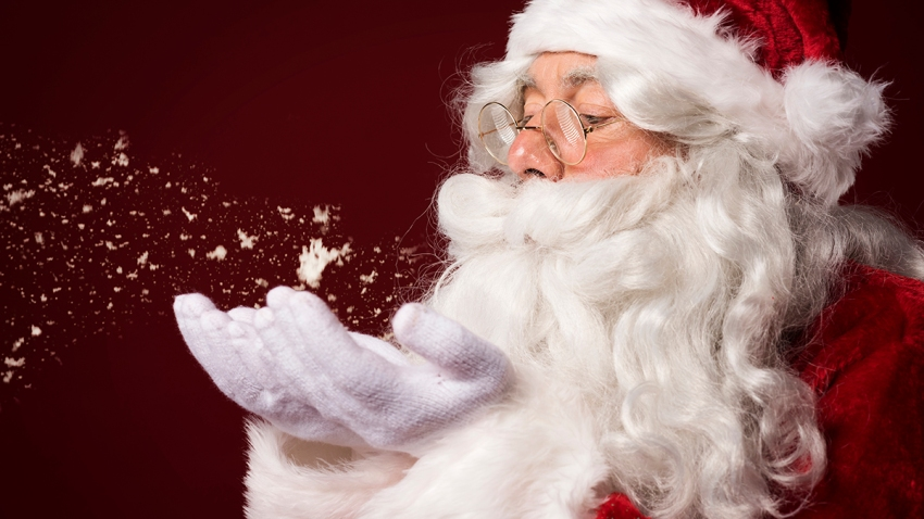 Santa Claus storyblocks-santa-claus-blowing-some-snowflakes_rvlxls-FqM