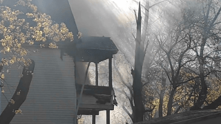 A house fire has closed a portion of Rhodes Street in New Britain.