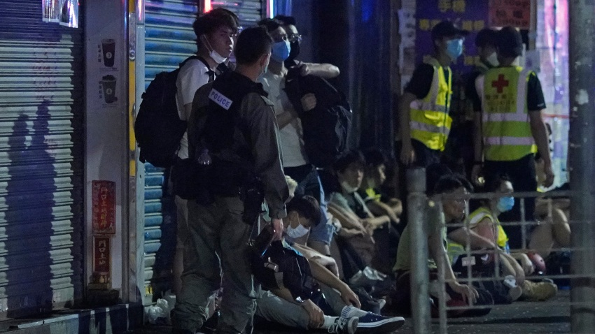 Police arrest anti-government protesters in Hong Kong, early Monday, May 11, 2020. A pro-democracy movement that paralyzed Hong Kong for months last year has shown signs of reviving in recent weeks as the coronavirus threat eases.