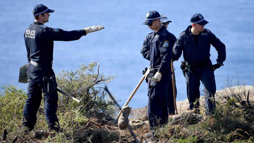 Police search a headland in Sydney, Tuesday, May 12, 2020, following an arrest in relation to the death of a man in 1998. More than 30 years after American mathematician Scott Johnson died after falling off a cliff in Sydney, a man has been charged with his death in an apparent gay hate crime that police believe was one of many over several decades in Australia's largest city.